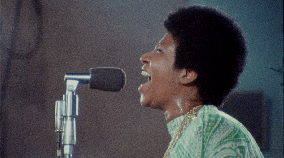 Image of Aretha Franklin performing at the New Temple Missionary Baptist Church in Watts, Los Angeles in 1972. An image from the documentary Amazing Grace.