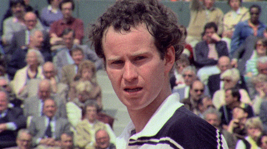 Archive coloured close-up image of John McEnroe playing tennis. A still from the documentary John McEnroe: In the Realm of Perfection.