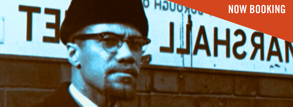 A black and white photograph of Malcom X , the American human rights activist. This is a still from the documentary Handsworth Songs.