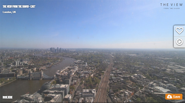 A panoramic CCTV camera installation from London's tallest building, The Shard. The sky is a bright, clear blue, and an eastward view of London bathes under the sun, far below.